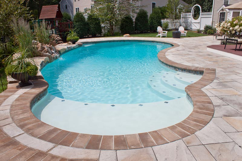 Gunite pools vinyl liner pools inground swimming pools for Vinyl swimming pool