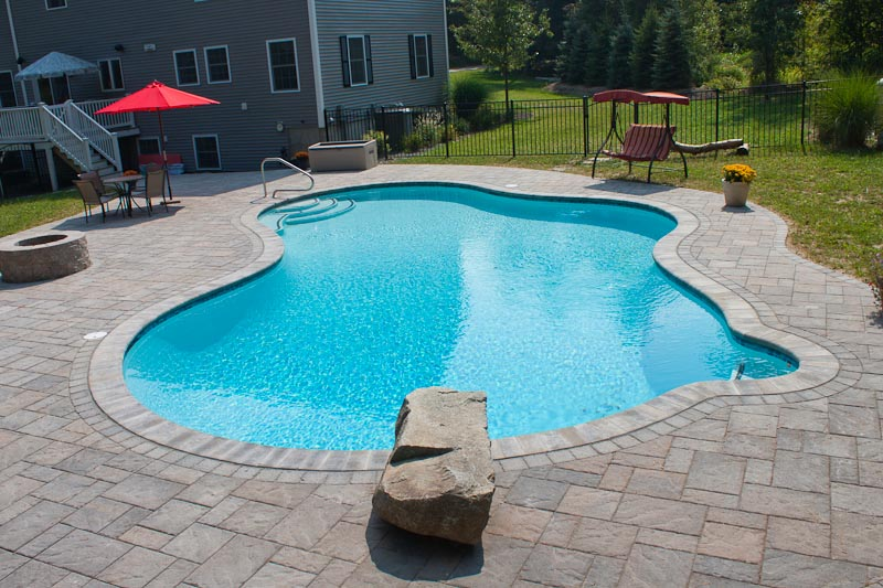 Inground pool patio designs a inground pool with tanning for Pool design options